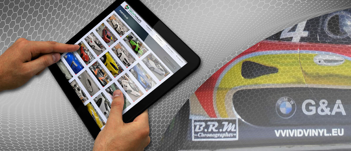 Portfolio image looking at a tablet of yacht wrapping and vehicle wrapping videos.